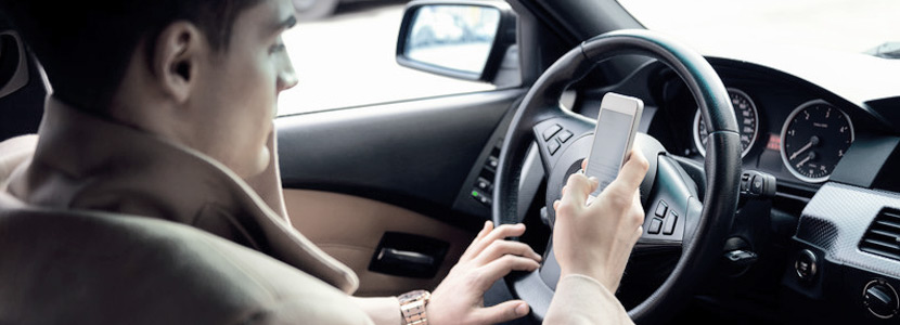 Mobile phones banned while driving